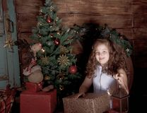 Happy little girl  decorate Christmas tree Stock Photos