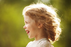 Happy little girl with disheveled hair Royalty Free Stock Image