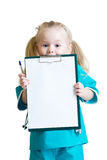 Happy little girl in doctor uniform with medical Royalty Free Stock Photos