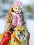 Happy little girl with a dog Royalty Free Stock Images