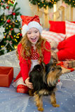 Happy Little girl and dog at Christmas Royalty Free Stock Photography