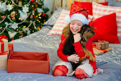 Happy Little girl and dog at Christmas Royalty Free Stock Image