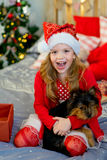 Happy Little girl and dog at Christmas Stock Photography