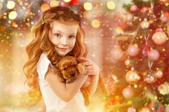 Happy little girl and dog beside Christmas tree. New year 2018. Holiday concept, Christmas, New year background. Happy little girl and dog beside Christmas tree Stock Images