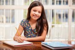 Happy little girl doing homework Royalty Free Stock Photo