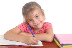Happy little girl doing homework Stock Photos