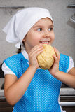 Happy little girl with a dough stock photography