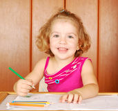Happy little girl drawing Stock Photography