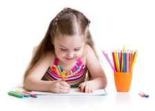 Happy little girl drawing with felt-tip pen in Royalty Free Stock Images
