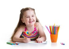 Happy little girl drawing with felt-tip pen in. Happy kid little girl drawing with felt-tip pen in preschool royalty free stock photography