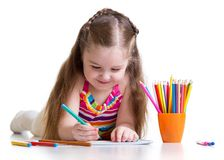 Happy little girl drawing with felt-tip pen in nursery Stock Image