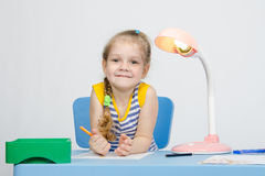 Happy little girl drawing pencils Royalty Free Stock Images