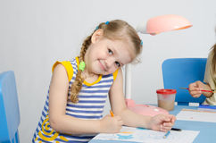 Happy little girl drawing pencils Stock Images