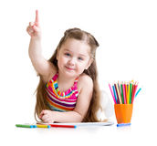 Happy little girl drawing with pencils in Royalty Free Stock Photo