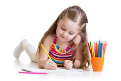 Happy little girl drawing with pencils in Royalty Free Stock Photos