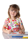 Happy little girl drawing a picture. On white Stock Image