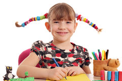 Happy little girl drawing Stock Images
