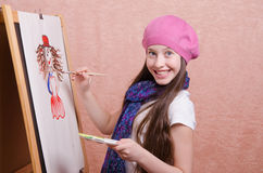 Happy little girl draws a picture Royalty Free Stock Photos