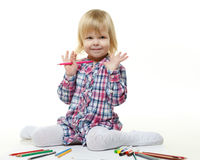 Happy little girl draws a picture. Royalty Free Stock Photos