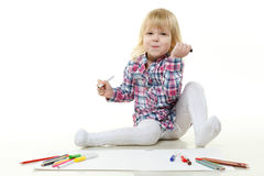 Happy little girl draws a picture. Stock Image