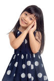 Happy little girl with dreaming pose Stock Photo