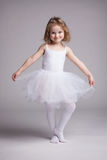 Happy little girl in dress ballerina royalty free stock images