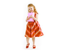 Happy little girl in dress with gift box Stock Images
