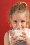 Happy Little Girl Drinking Mil Royalty Free Stock Photo