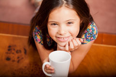 Happy little girl drinking tea Royalty Free Stock Images