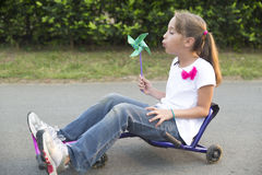 Happy Little Girl Driving Her Toy Royalty Free Stock Photos