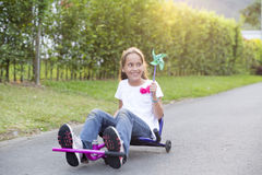 Happy Little Girl Driving Her Toy Stock Photo