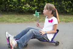 Happy Little Girl Driving Her Toy Royalty Free Stock Image