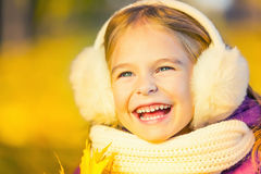 Happy little girl in earflaps Royalty Free Stock Photo