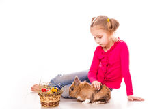 Happy little girl with easter bunny and eggs. Happy Easter Royalty Free Stock Photos