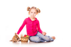 Happy little girl with easter bunny and eggs. Happy Easter Stock Photo