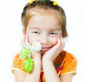 Happy little girl with easter eggs. Stock Image