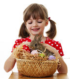 Happy little girl with easter rabbit. Isolated Royalty Free Stock Image