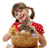 Happy little girl with easter rabbit. Isolated on white Stock Image