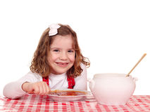 Little girl eat tomato soup Stock Photo