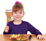 Happy little girl eating Stock Images
