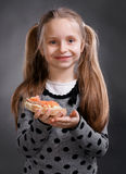 Happy little girl eating bread and butter with fish Royalty Free Stock Photography