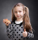 Happy little girl eating bread and butter with fish Stock Image