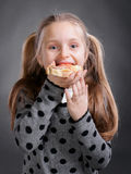 Happy little girl eating bread and butter with fish Royalty Free Stock Photo
