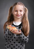 Happy little girl eating bread and butter with fish Royalty Free Stock Photos