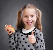 Happy little girl eating bread and butter with fish Stock Photography