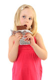 Happy little girl eating chocolate Stock Images