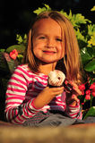 Happy little girl eating a cupcake royalty free stock images