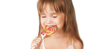 Happy little girl eating a lollipop candy Stock Photography
