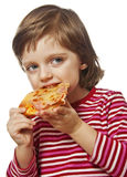 Happy little girl eating pizza Stock Photography
