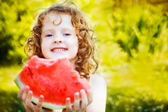 Happy little girl eating watermelon in summer park. Instagram fi Royalty Free Stock Photos